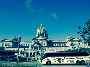 Coach bus in front of the capital.